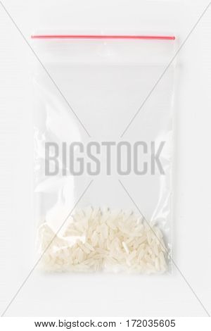 Plastic Transparent Zipper Bag With A Little Uncooked White Basmati Rice Isolated On White, Vacuum P