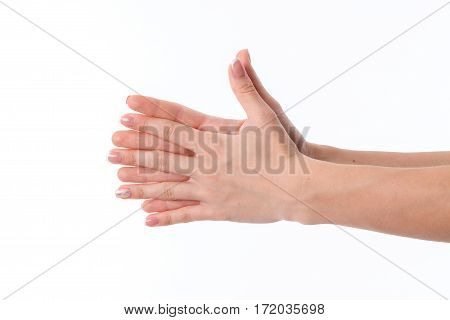 women's hands with crossed palms and fingers between them is isolated on a white