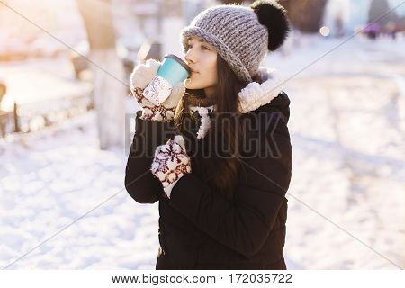 Portrait Of Young Woman Drinking Tea Outdoors At Winter Street.