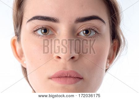 Portrait of serious young girl without makeup