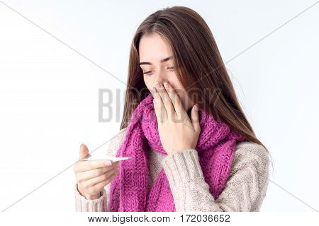 the girl in the scarf became ill and looks temperature isolated on white