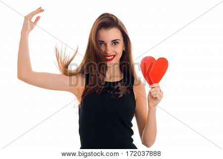 Happy brunette girl in black dress with nice make up celebrate Valentines day with red heart in her hands isolated on white