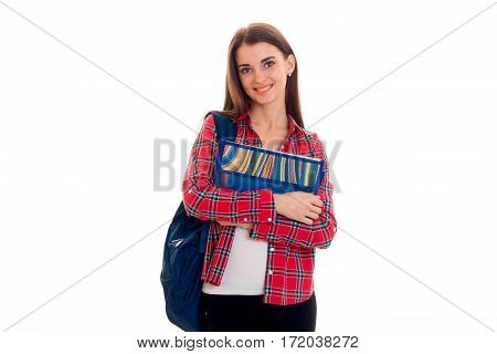 cheerful stylish smart student girl with backpack on her shoulders and folders for notebooks in hands posing and smiling on camera isolated on white