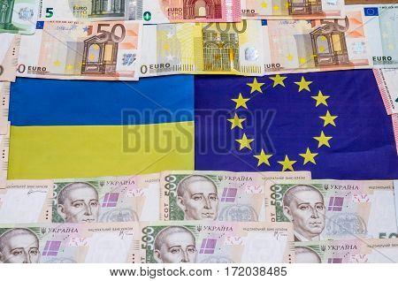 ukraine and europe flag with money close up