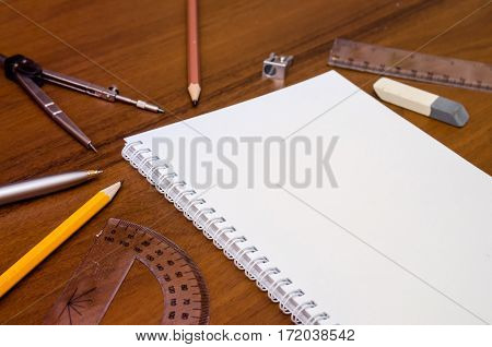 Office Workplace - Empty Notepad, Pen, Pencil, Ruler, Compass On Dark Wooden Background