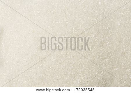 Granulated White Textured Sugar Sand As Background.