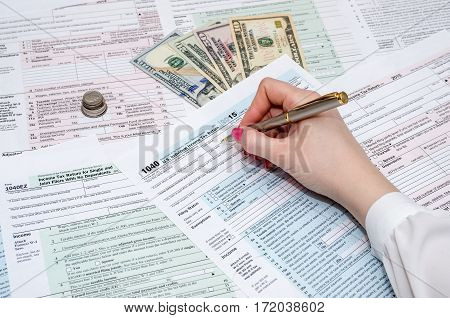Business Woman Working With Tax Form Documents With Money