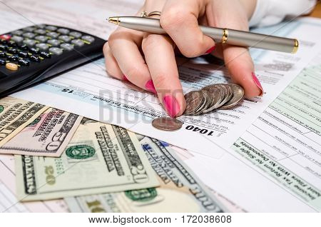 Business Woman Holding Pen And Calculator On Tax  Form 1040
