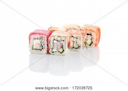 Roll rainbow, salmon, eel, shrimp, octopus, squid, tuna on a white background