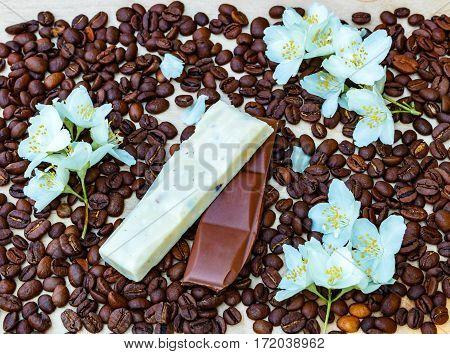 Pieces Of White And Milk Chocolate. Jasmine Flowers. Black Coffee