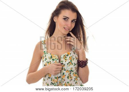 adorable young brunette woman take off her sarafan with floral pattern and seduce on camera isolated on white