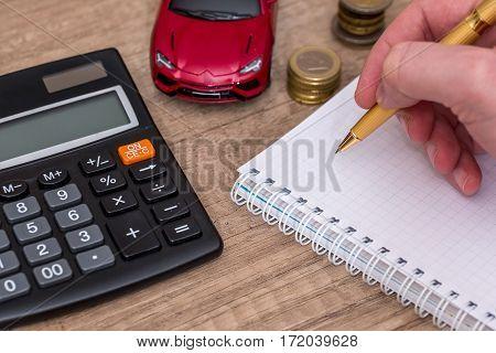 Car insurance concept - notepad, car, calculator