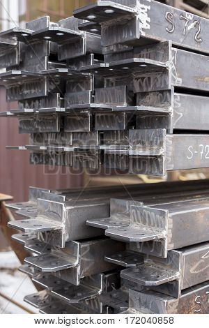 Closeup stack of steel bar heap with lug. Steel construction.