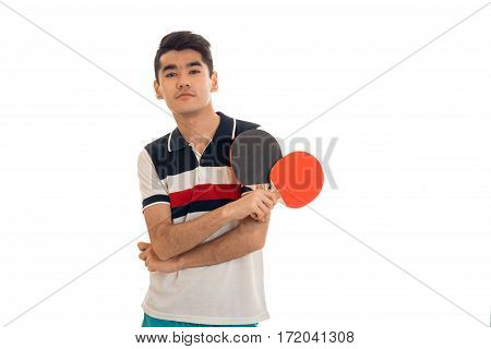portrait of young sportsman practicing a ping-pong and looking at the camera isolated on white