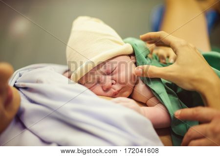 Newborn baby in the hospital, In the hands of the mother