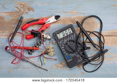 Electrical tools and parts on the table from old boards