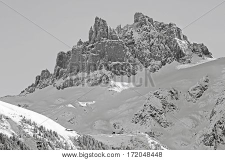 View of Fuerenalp with the spectacular Peaks of Spannort Mountain in the back Engelberg Valley Switzerland