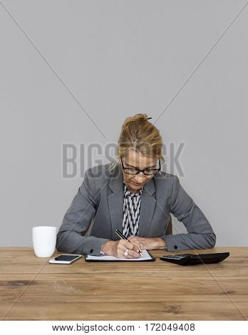 Businesswoman writing down a plan and strategy