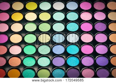 Close-up of colorful makeup powder. Makeup eyeshadow palette