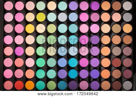 Colorful beauty eyeshadow make-up background. Make-up eyeshadow palette