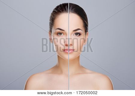 Comparison portrait of woman. Divided face of woman. One half of face with retouch and without make-up, before. Another half of face with make-up, after. Studio, head and shoulders, indoors. Gray background
