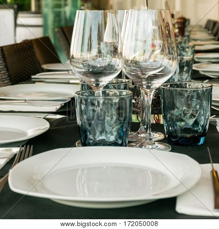 Closeup of table setting in restaurant outdoors prepared for dinner or event