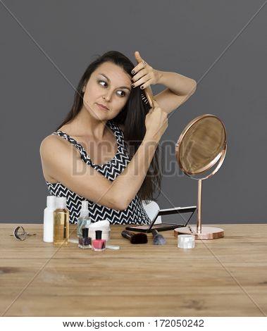 Elegance woman wearing makeup herself