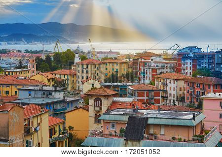 La Spezia And Gulf Of Spezia With Light Beams At Sunrise