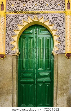 Moroccan mosque green door in Tanger, Morocco