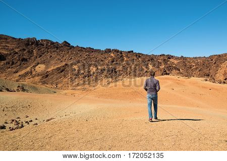 Man in Teide National Park in Tenerife Canary Islands Spain
