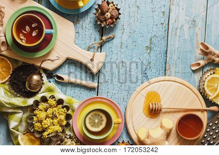 Cups With Herb Tea And Pieces Of Lemon, Dried Herbs And Different Decorations