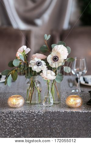 Wedding , festive decor. Bouquet from spring flowers. Table layout. Table of newly married. Restaurant interior.