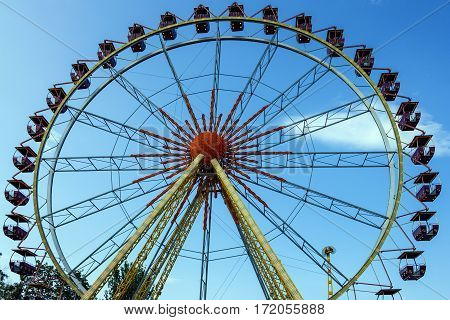 Ferris wheel in the amusement park in evening, Odessa, Ukraine.