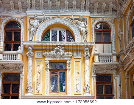Odessa, Ukraine: sculptures of modernist style on the balcony of Odessa passage - old covered mall and architectural monument.