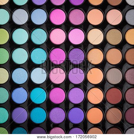Colorful eyeshadow make-up palette background or texture