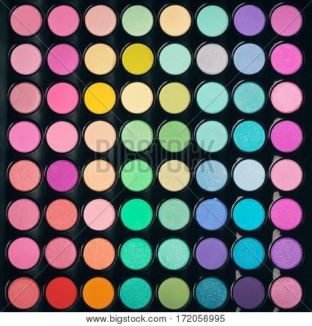 Colorful make-up eyeshadow palette background. Flat lay