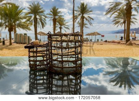Dinner table at sandy beach of the Red Sea, selective focus on the table