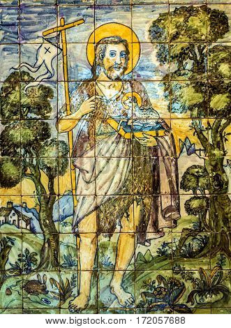 LISBON, PORTUGAL - APRIL 21, 2017: Ceramic tile icon of Saint Jon Baptist, museum Azulejo, Lisbon, Portugal.