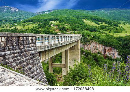 Bridge mountain landscape, Montenegro. Durdevica Tara arc bridge in the mountains. One of the highest automobile bridges in Europe.