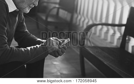 Senior Man Sit Thoughful Hands Hold Mobile