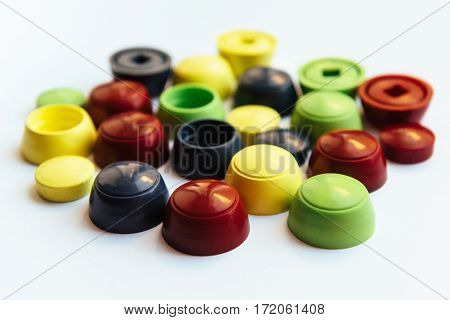Colored plastic caps isolated on white background.