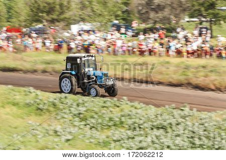 Trucks races on off road terrain. Races without rules. Races on a cross-country terrain. Tractor in splashing mud.