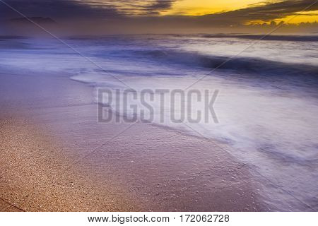 A beautiful sunrise over a deserted beach.