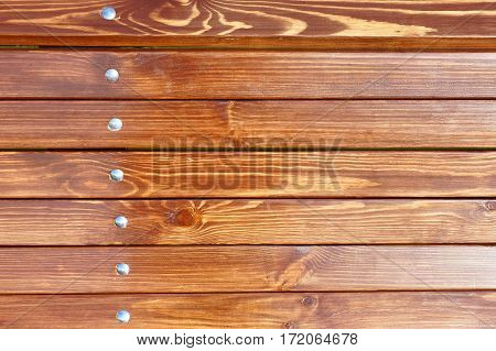Background and wooden beams with metal rivets