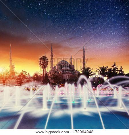 Sultan Ahmed Mosque Illuminated. Fantastic starry sky. Istanbul, Turkey