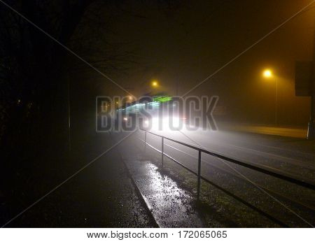 Photo of a tram driving through the darkness