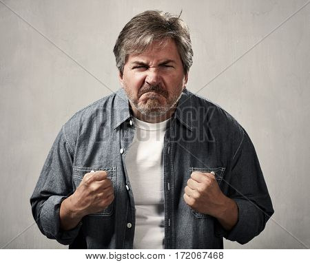 Angry fury man portrait. People face expressions.