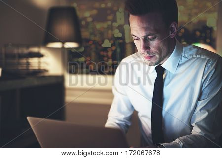 Businessman Working On Laptop At Night
