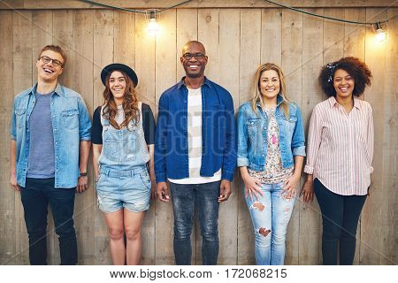 Friends Standing At Wooden Wall