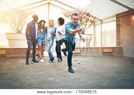 Guy Playing Petanque Indoors With Friends